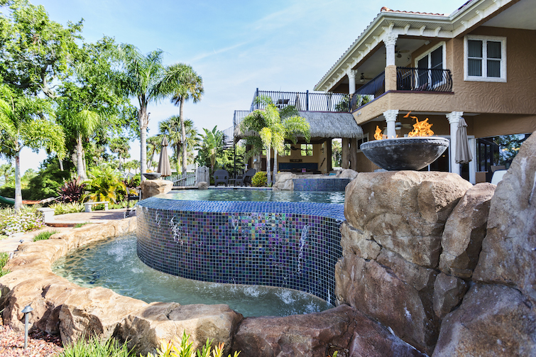 custom swimming pool water feature in backyard